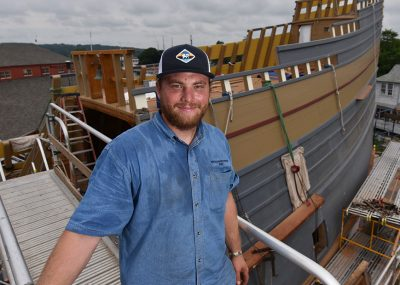 Casey Cochran takes a break while working to restore the Mayflower II.