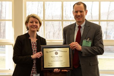 Thomas Van Hoof, pictured on the right, receives the Center for Excellence in Teaching and Learning (CETL) award from Aynsley Diamond, director of faculty outreach and engagement at CETL.
