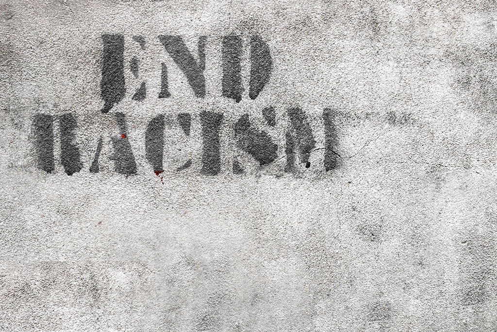 End Racism graffiti.