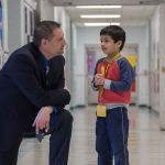 Daniel J. Crispino with elementary school student.
