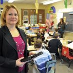 Sandra Chafouleas hold booking in classroom.