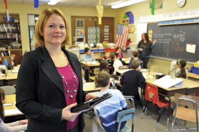 Sandra Chafouleas hold books in classroom.