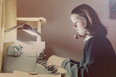 Julie Wood typing on manual typewriter.