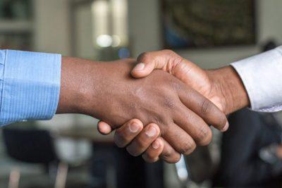 Handshake to illustrate pandemic partnerships.