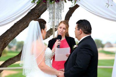 Melissa Thom officiates a wedding ceremony.