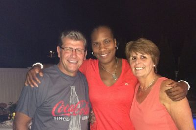 Geno Auriemma, Jamelle Elliott, and Kathy Auriemma.