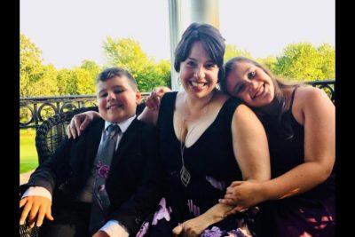 Lauren Rodriguez smiles with her two children.