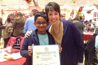 Principal Rodriguez with student receiving award.