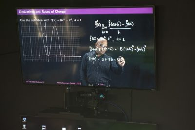 Amit Savkar at a Lightboard. His startup uses AI to support math learning.