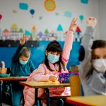 Kids wearing masks in classroom.