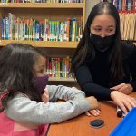 Isabella Gradante works with young student.