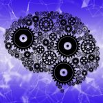 Brain graphic with gears.