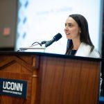 Elizabeth Devitto speaks at a Neag School podium.